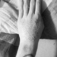 Beautiful white ink pattern tattoo on hand