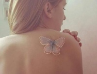Lovely white ink butterfly tattoo on back