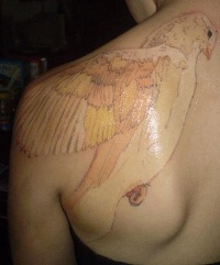 White ink tattoo with very nice bird